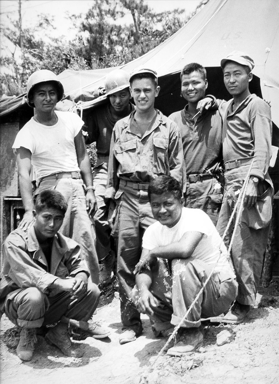 Donald Keene (standing at center) pictured with Japanese-American subordinates during the time he was assigned in Okinawa as a translator and interpreter from April to July 1945. (Courtesy Donald Keene Center Kashiwazaki)