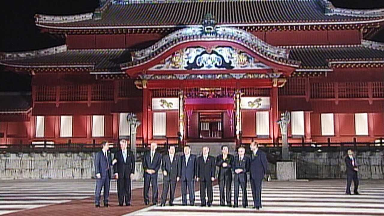 Heads of state stand outside the main hall of Shuri Castle during the July 2000 G8 Summit.