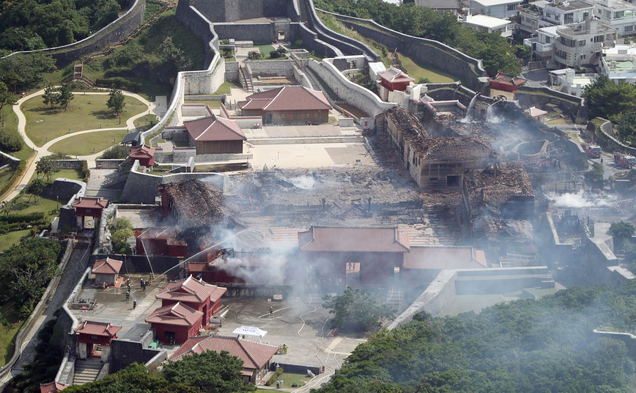 Shuri Castle pictured after the conflagration of October 31, 2019, in which the main hall (center) was completely destroyed. (© Jiji)