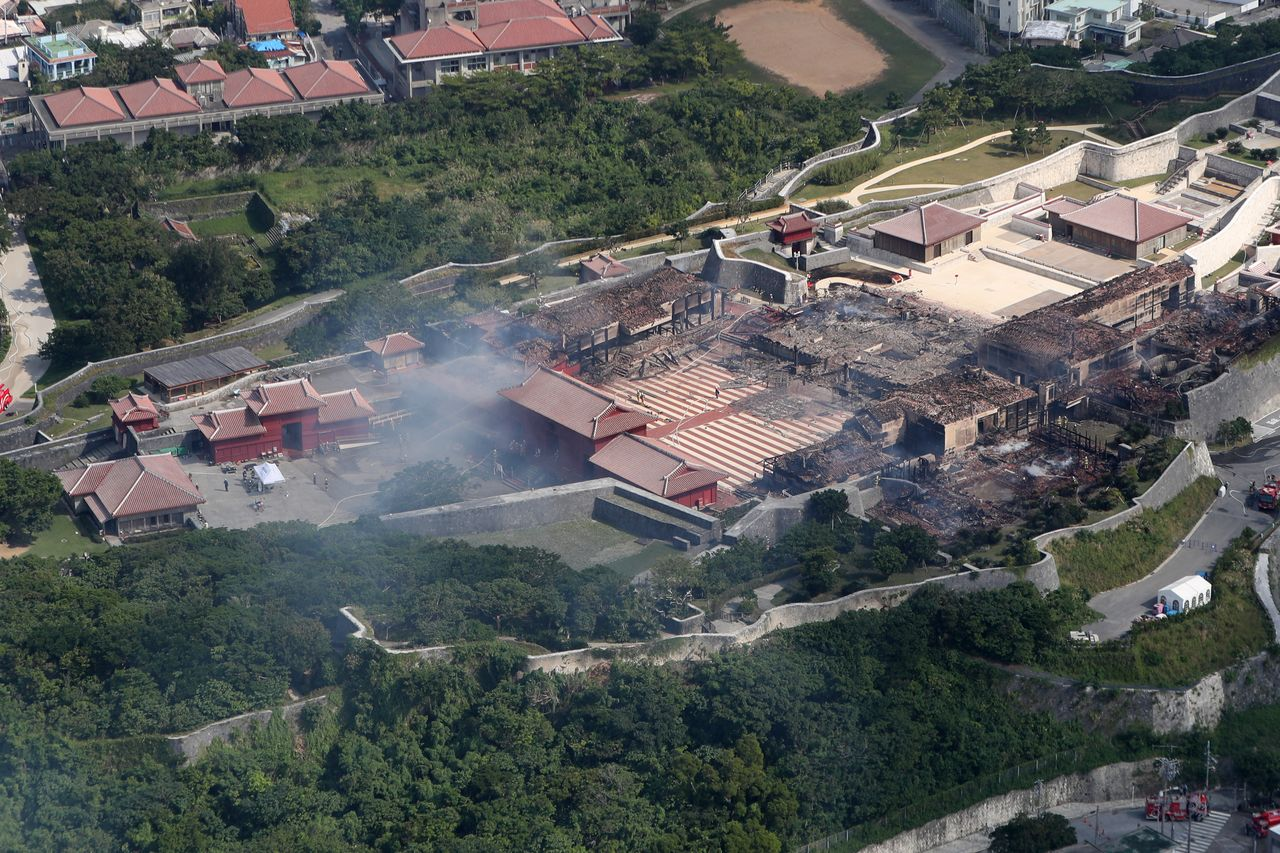 The smoldering ruins of Shuri Castle in Okinawa on the morning of October 31. (© Jiji)