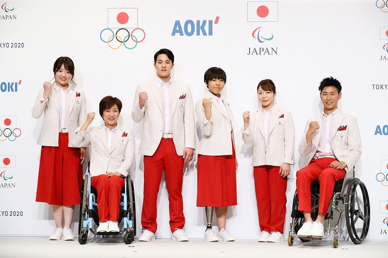 Official Japanese Olympic and Paralympic uniforms at the launch event in Tokyo on January 23, 2020. (© Jiji)