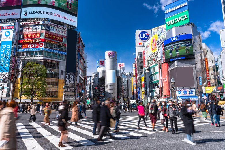 A file photo of the scramble intersection in Shibuya. Reducing the crowds commonly seen at this and other popular spots will be key to reducing the virus's spread.