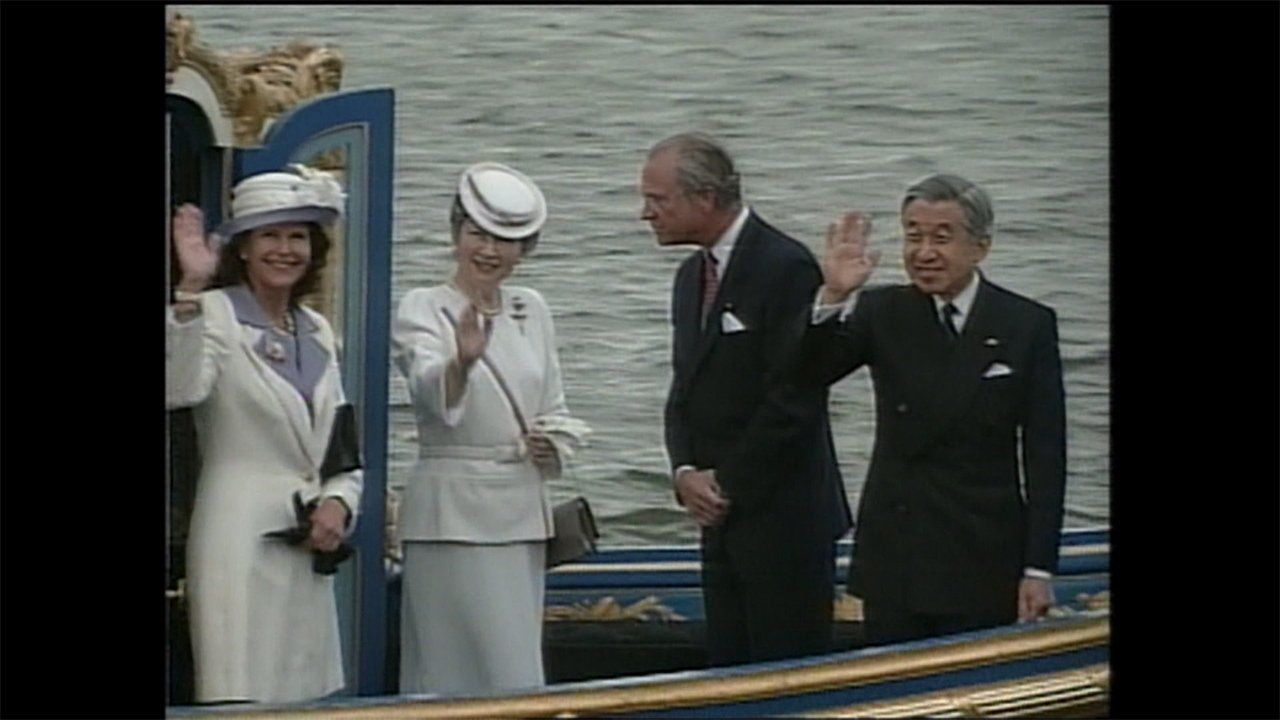 Emperor Akihito (left) and Empress Michiko (center) during their 2000 trip to Europe.