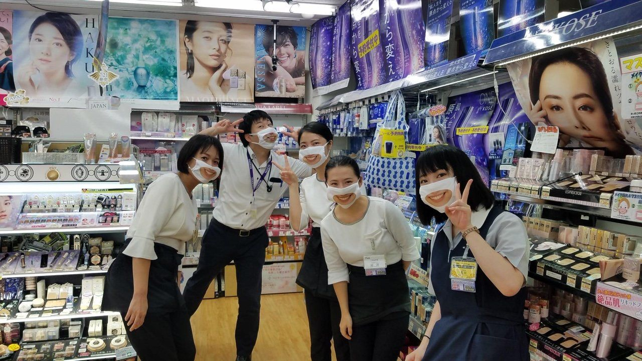 Staff in the cosmetics corner show off their smile masks. (Courtesy of Takeya)