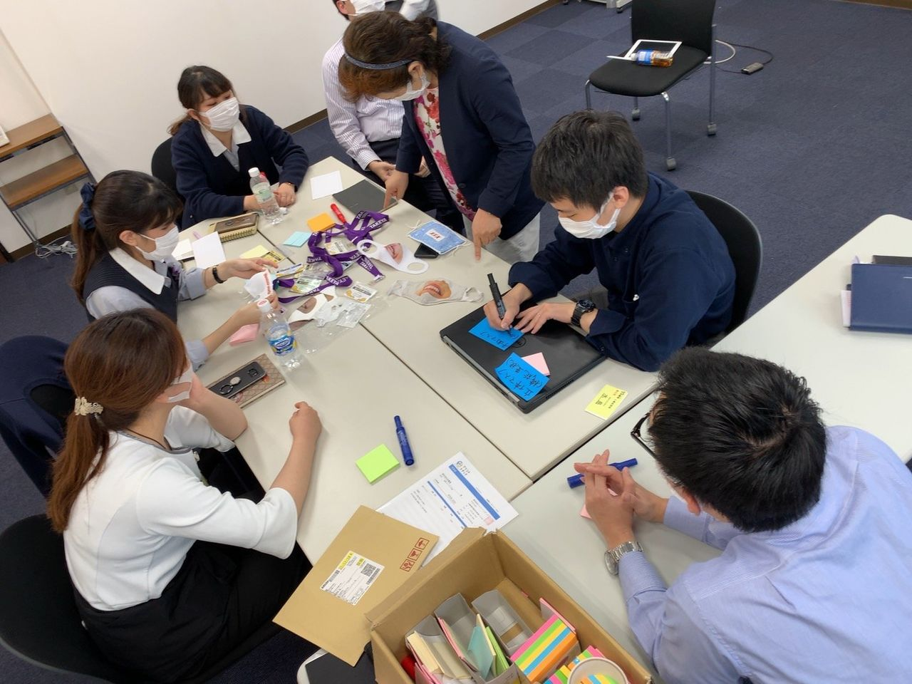 Team members of the smile mask project during a meeting. (Courtesy of Takeya)