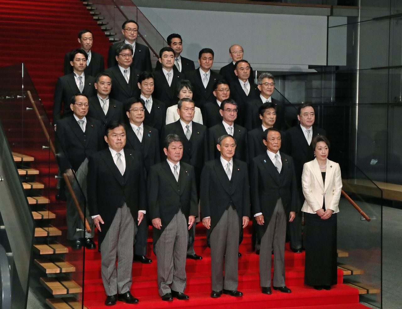 Prime Minister Suga Yoshihide, at front center, poses with his new cabinet on September  16 at the Kantei. (© Jiji)