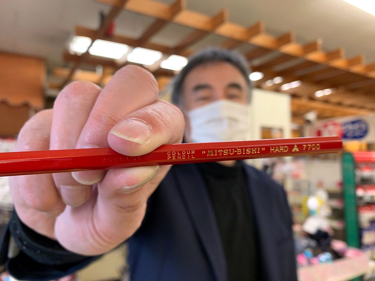 Naoya Nagatsuma, 11th-generation owner of Tokyo stationery store Soumaya Genshirou Shouten, holds a Mitsubishi pencil in Tokyo, Japan, February 3, 2021. REUTERS/Chang-Ran Kim REUTERS/Chang-Ran Kim