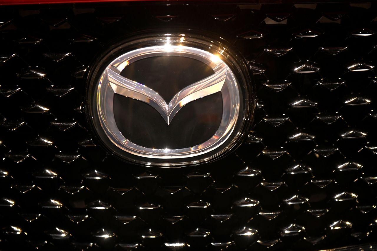 FILE PHOTO: The logo of Mazda is pictured at the LA Auto Show in Los Angeles, California, U.S., November 20, 2019. REUTERS/Andrew Cullen