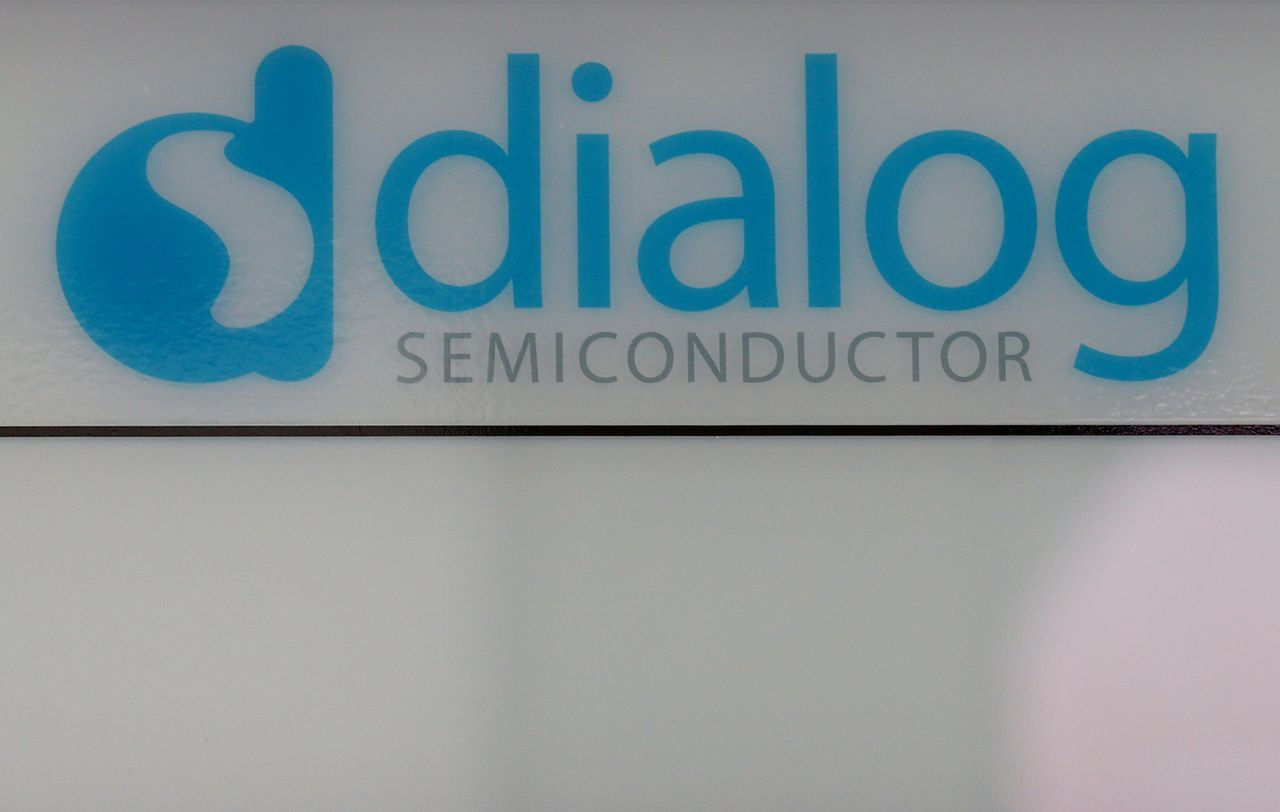 FILE PHOTO: Dialog semiconductor logo is pictured at a company building in Germering near Munich, Germany August 15, 2016. REUTERS/Michaela Rehle