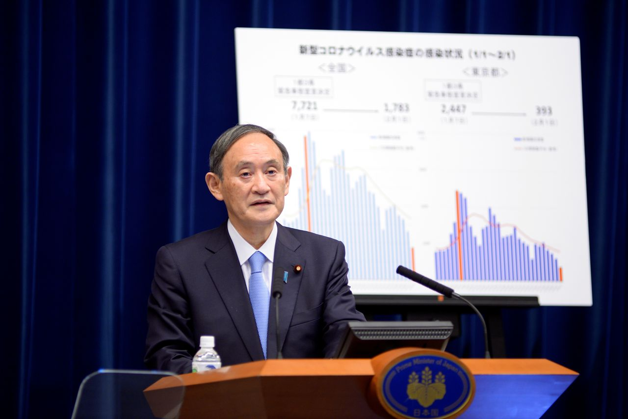 FILE PHOTO: Japan's Prime Minister Yoshihide Suga addresses a news conference on the coronavirus disease (COVID-19) situation at the prime minister's official residence in Tokyo, Japan February 2, 2021. David Mareuil/Pool via REUTERS