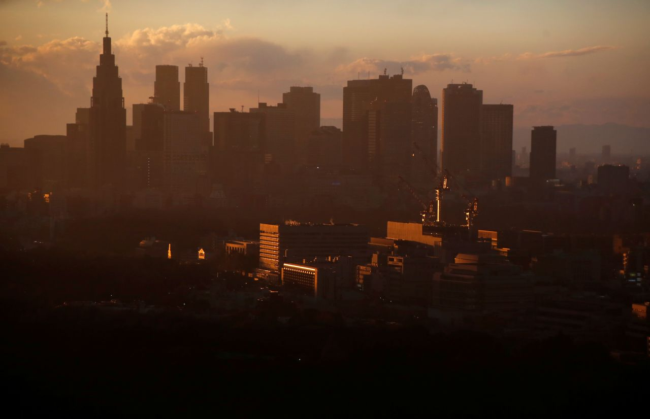 FILE PHOTO: High-rise buildings are seen at the Shinjuku business district during sunset in Tokyo, Japan, March 7, 2017. REUTERS/Toru Hanai