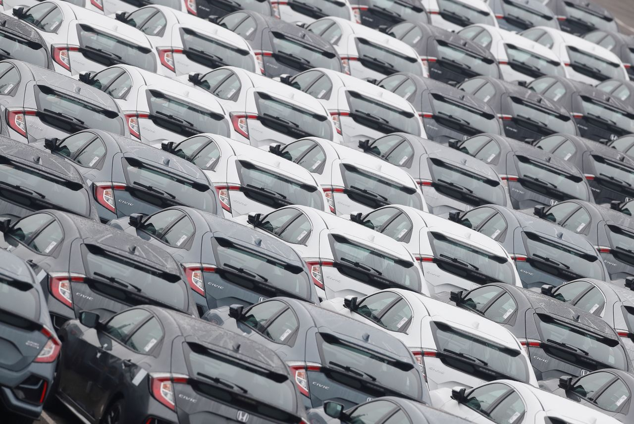 FILE PHOTO: Rows of Honda Civic cars are lined up in the docks following the end of the Brexit transition period in Southampton, Britain, January 1, 2021. REUTERS/Matthew Childs