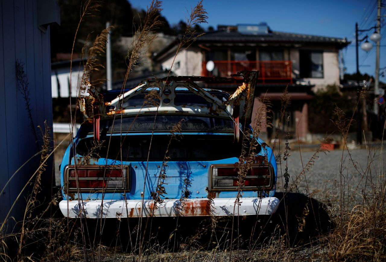An abandoned car sits in a restricted zone in Futaba, Fukushima Prefecture, Japan, February 19, 2021. REUTERS/Kim Kyung-Hoon