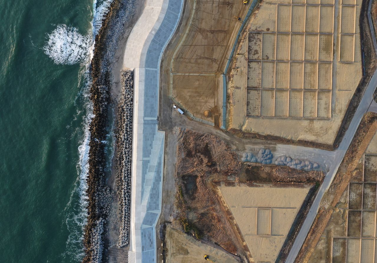 An aerial view of a seawall under construction in Namie, Fukushima Prefecture, Japan, February 21, 2021. Picture taken with a drone. REUTERS/Kim Kyung-Hoon