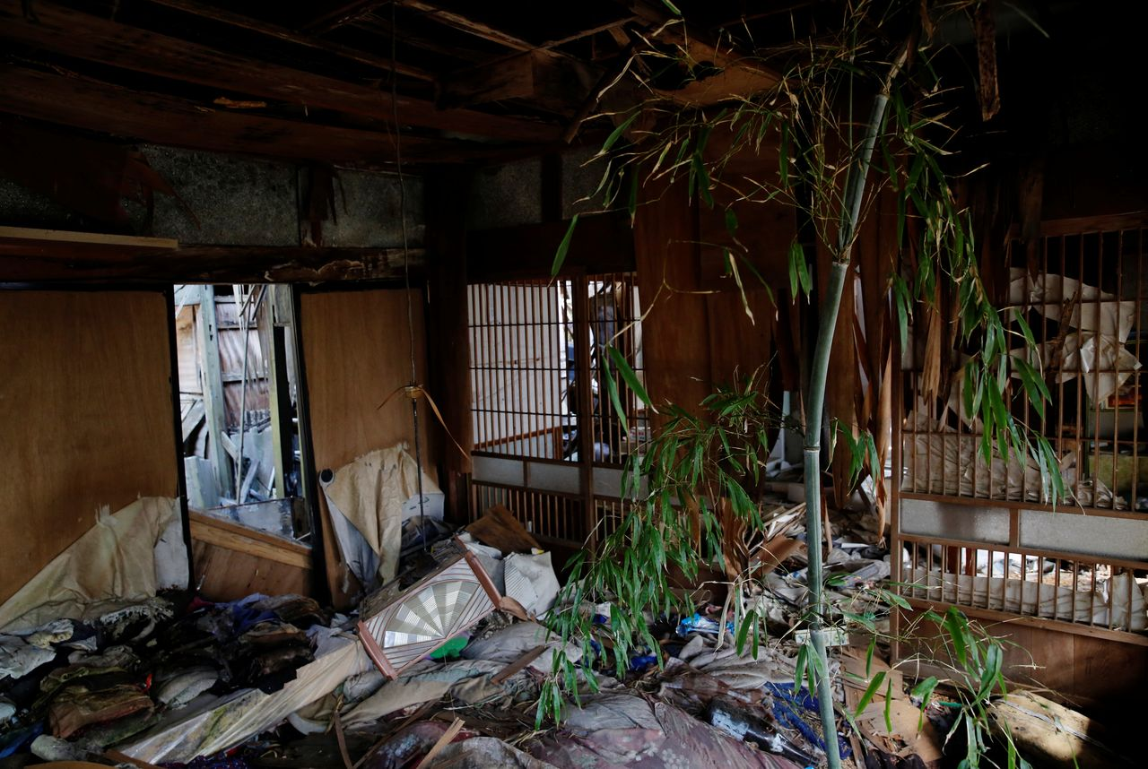 A bamboo tree grows inside Hisae Unuma's collapsing home that she lived in before being evacuated, which is 2.5 km away from the crippled Fukushima nuclear power plant, in a restricted zone in Futaba, Fukushima prefecture, Japan, February 23, 2021. Unuma fled as the cooling system at Tokyo Electric Power Co's nuclear plant failed and its reactors began to melt down. Her home withstood the earthquake a decade ago but is now close to collapsing after years of being battered by wind, rain and snow. I'm surprised it's still standing,