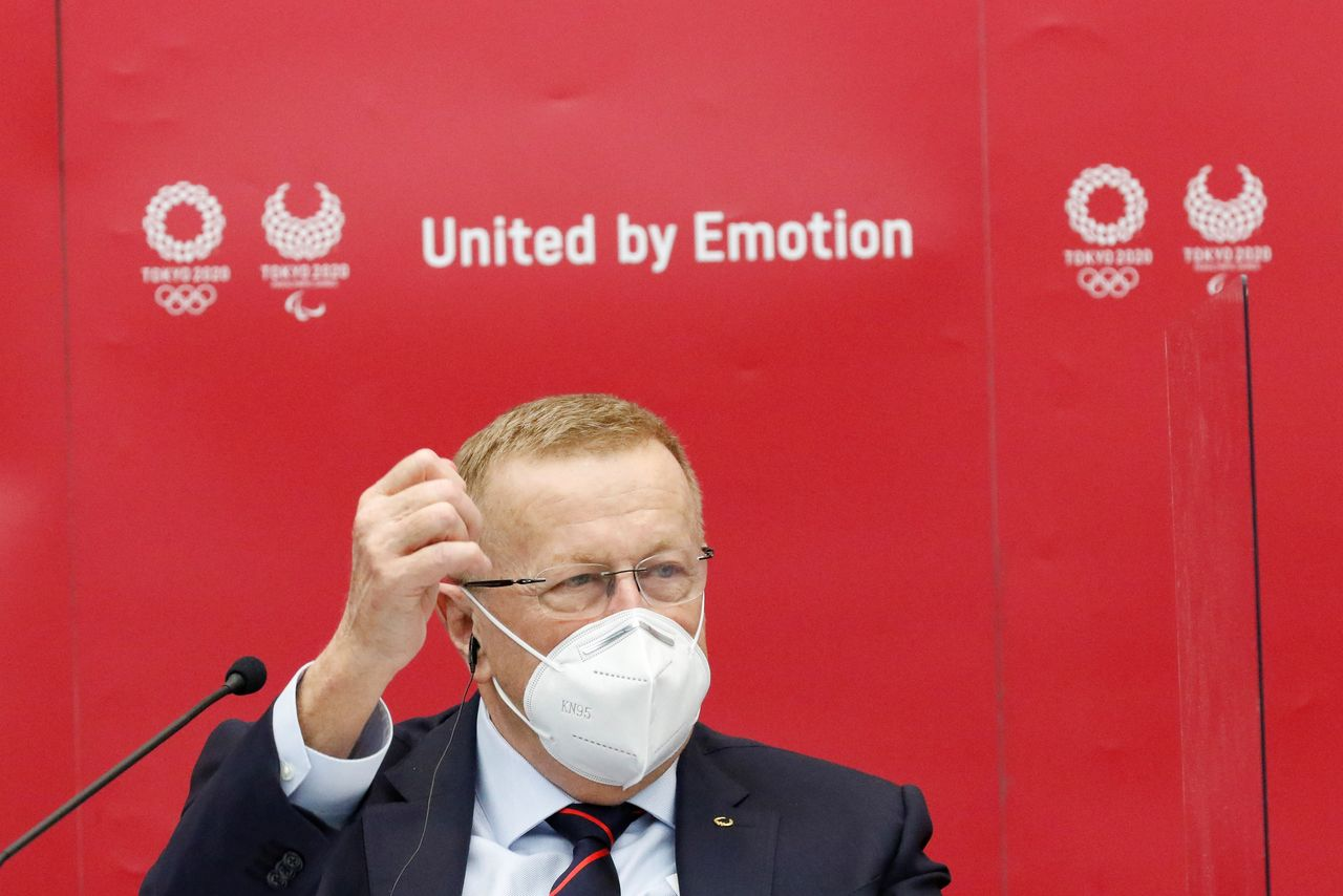 FILE PHOTO: John Coates, Chairman of the Coordination Commission for the Games of the XXXII Olympiad Tokyo 2020, wears a face mask as he speaks during a joint press conference with the organizers of Tokyo 2020 at Harumi Island Triton Square Tower Y in Tokyo, Japan November 18, 2020. Rodrigo Reyes Marin/Pool via REUTERS