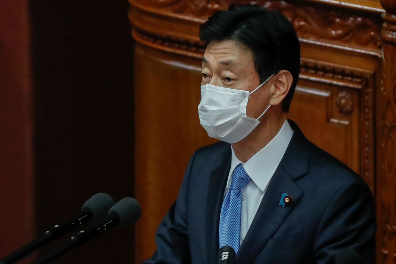 FILE PHOTO: Japan's Economy Minister and minister in charge of coronavirus response Yasutoshi Nishimura delivers his policy speech at the opening of the Lower House plenary session in Tokyo, Japan January 18, 2021. REUTERS/Issei Kato