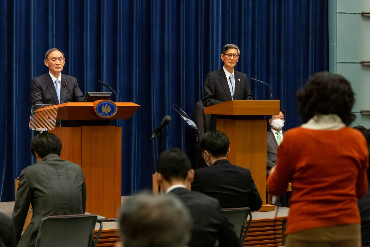 Japanese Prime Minister Yoshihide Suga holds a news conference with President of the Japan Community Healthcare Organization Shigeru Omi in Tokyo, Japan March 5, 2021. Yuichi Yamazaki/Pool via REUTERS