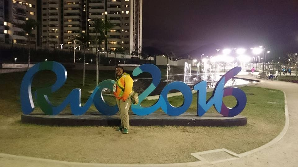 Claire Dawn-Marie Gittens poses with a Rio Olympics signage in Rio de Janeiro, Brazil in 2016. Picture taken in 2016. Claire Dawn-Marie Gittens/Handout via REUTERS