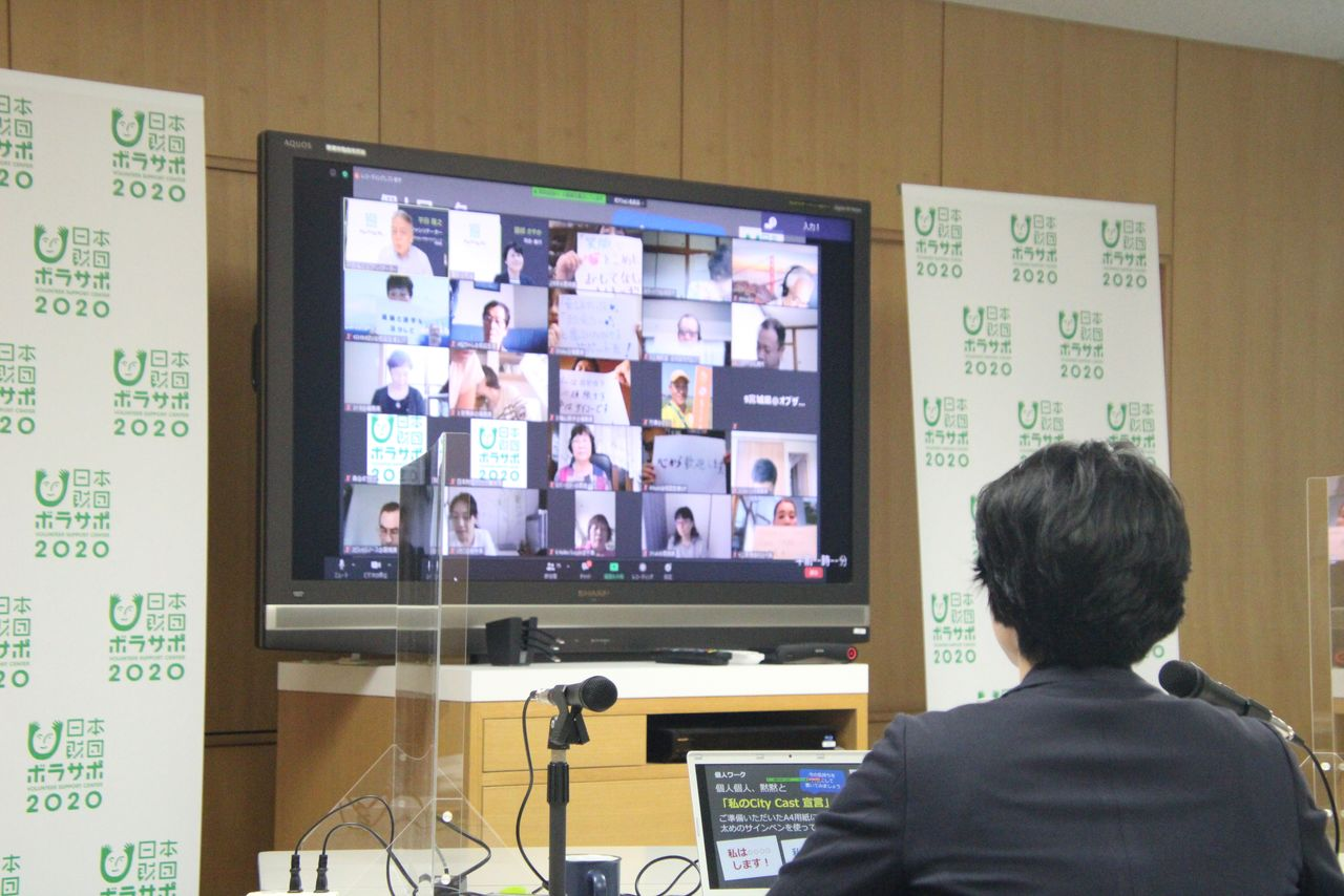 A screen displays an online gathering with volunteers for the 2020 Olympics in Tokyo, Japan July 2020. Picture taken in July 2020. Nippon Foundation Volunteer Support Centre/Handout via REUTERS