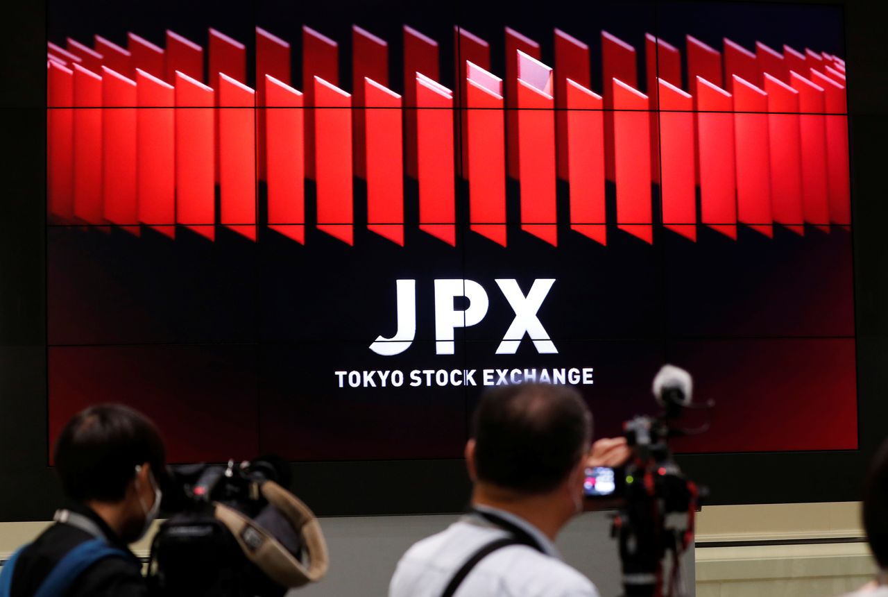 FILE PHOTO: TV camera men wait for the opening of market in front of a large screen showing stock prices at the Tokyo Stock Exchange in Tokyo, Japan October 2, 2020. REUTERS/Kim Kyung-Hoon