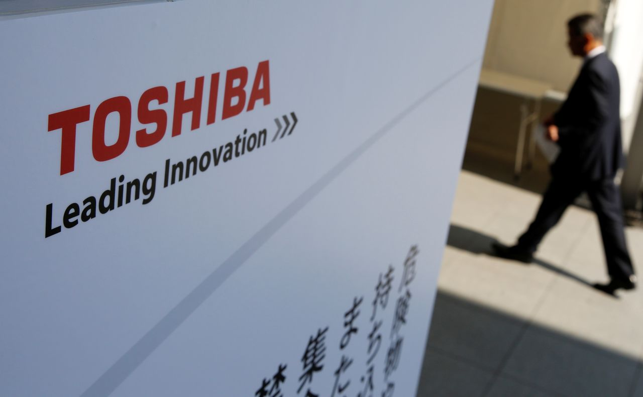 FILE PHOTO: The logo of Toshiba is seen as a shareholder arrives at Toshiba's extraordinary shareholders meeting in Chiba, Japan March 30, 2017. REUTERS/Toru Hanai