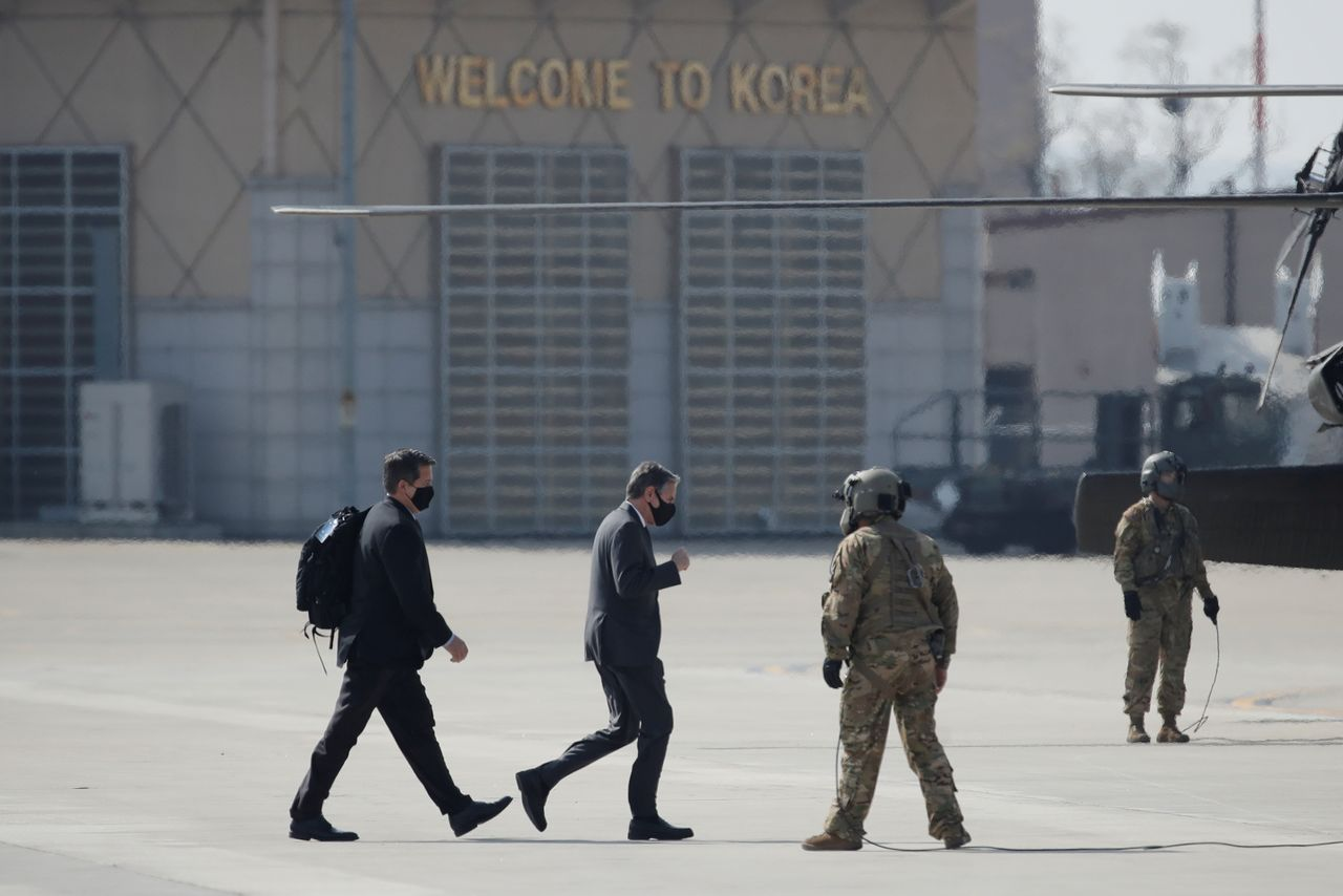 U.S. Secretary of State Antony Blinken, center, walks to board a helicopter upon his arrival at Osan Air Base in Pyeongtaek, South Korea March 17, 2021. Lee Jin-man/Pool via REUTERS