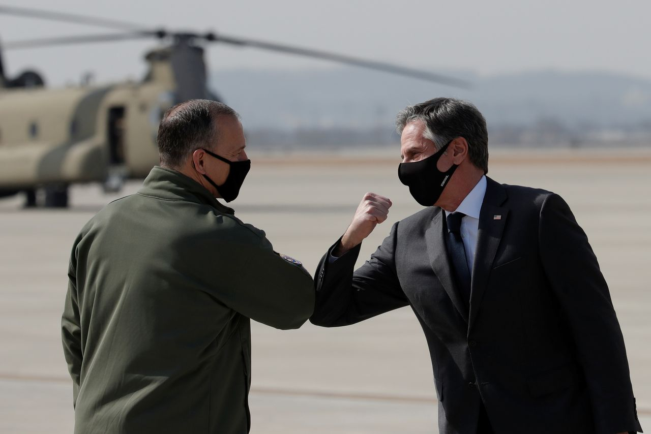 U.S. Secretary of State Antony Blinken, right, greets with Lieutenant General Scott Pleus, Deputy Commander of United States Forces Korea, upon his arrival at Osan Air Base in Pyeongtaek, South Korea March 17, 2021. Lee Jin-man/Pool via REUTERS