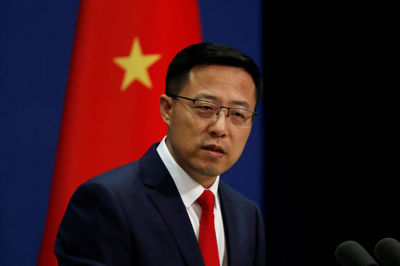 FILE PHOTO: Chinese Foreign Ministry spokesman Zhao Lijian attends a news conference in Beijing, China September 10, 2020. REUTERS/Carlos Garcia Rawlins