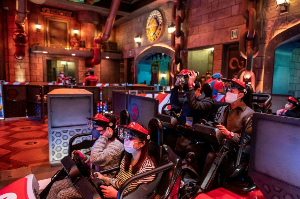 Augmented reality goggles attached to a plastic red visor are used in the 'Mario Kart' ride. Philip FONG/AFP