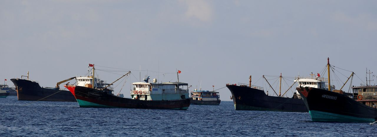 FILE PHOTO: Chinese fishing vessels are pictured at the disputed Scarborough Shoal April 6, 2017. REUTERS/Erik De Castro