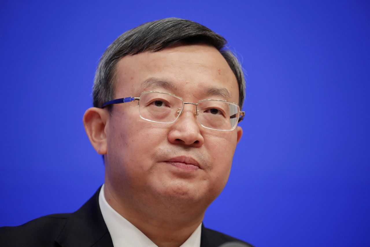 FILE PHOTO: Chinese Vice Commerce Minister and Deputy International Trade Representative Wang Shouwen attends a news conference on the state of trade negotiations with U.S. in Beijing, China December 13, 2019. REUTERS/Jason Lee