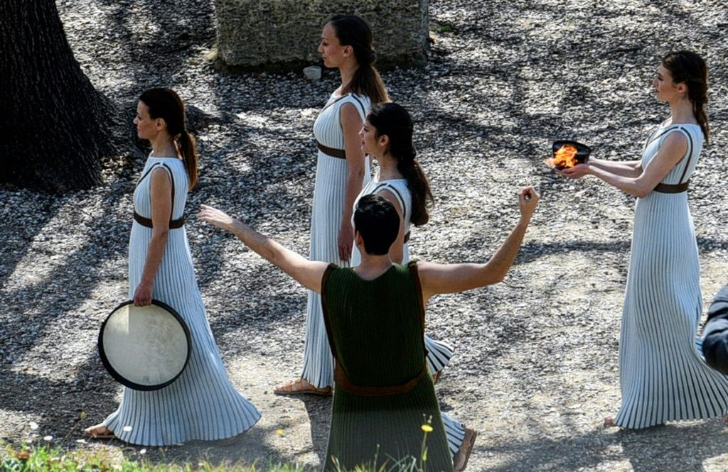 Greek actress Xanthi Georgiou holds the Olympic flame at the Temple of Hera during a dress rehearsal on March 11, 2020. AFP/File