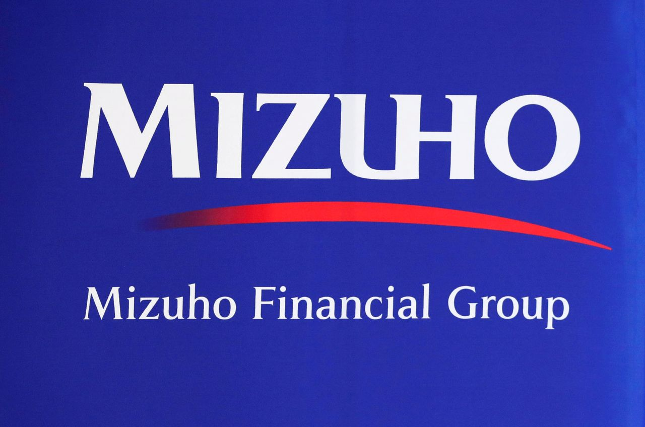 FILE PHOTO: Mizuho Financial Group logo is seen at the company's headquarters in Tokyo, Japan August 20, 2018. Picture taken August 20, 2018. REUTERS/Toru Hanai