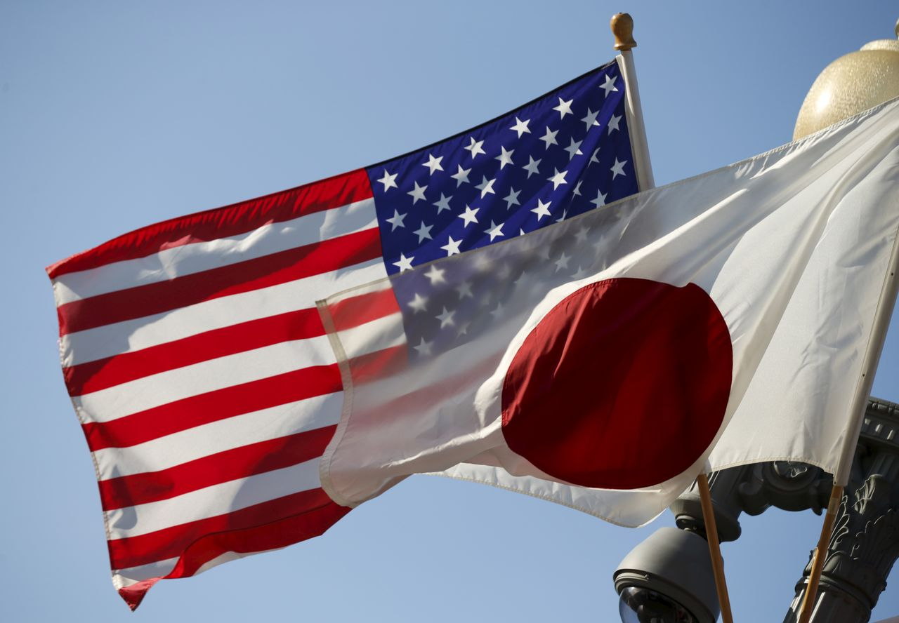 FILE PHOTO: The U.S. and Japan flags fly together outside the White House in Washington April 27, 2015. Japanese Prime Minister Shinzo Abe will meet with U.S. President Barack Obama on Tuesday as part of his eight day visit to the United States. REUTERS/Kevin Lamarque/File Photo