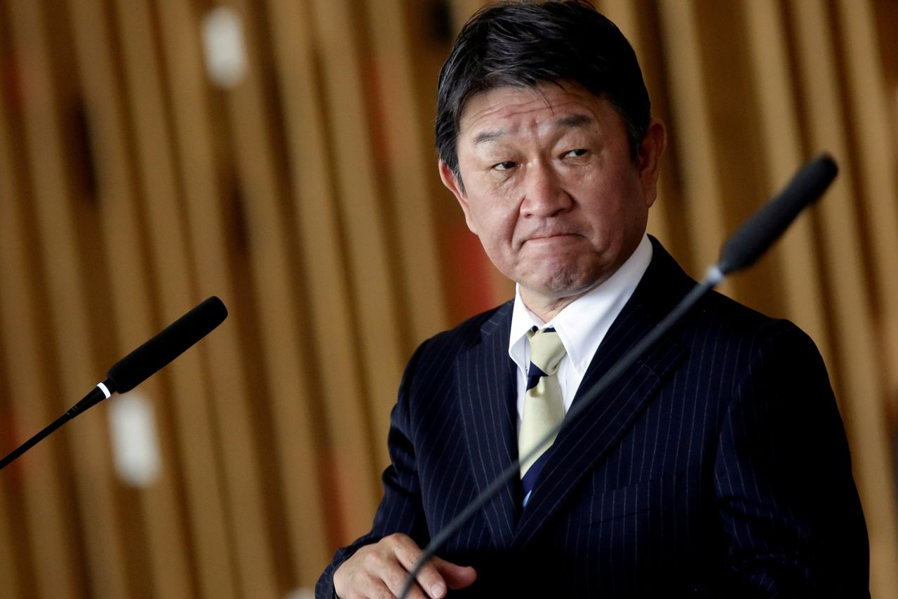 FILE PHOTO: Japan's Foreign Minister Toshimitsu Motegi looks on during a statement to the media at the Itamaraty Palace in Brasilia, Brazil, January 8, 2021. REUTERS/Adriano Machado/File Photo