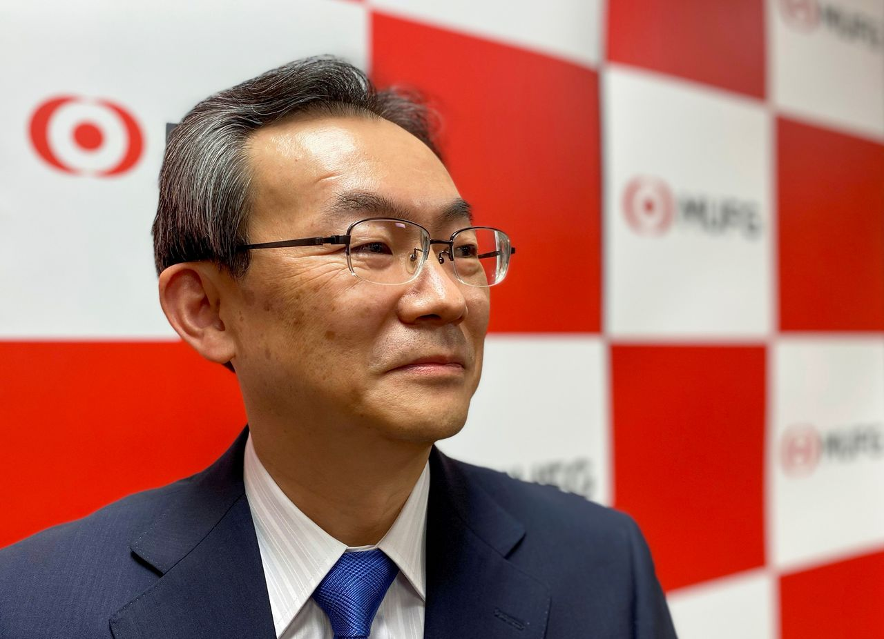 FILE PHOTO: Junichi Hanzawa, CEO of Japan's Mitsubishi UFJ Financial Group banking unit, poses for a photograph during an interview with Reuters in Tokyo, Japan March 26, 2021. REUTERS/Takashi Umekawa
