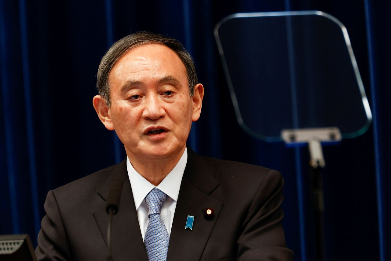 FILE PHOTO: Japan's prime minister, Yoshihide Suga, speaks during a press conference at the prime minister's official residence in Tokyo, Japan March 18, 2021. Rodrigo Reyes Marin/Pool via REUTERS