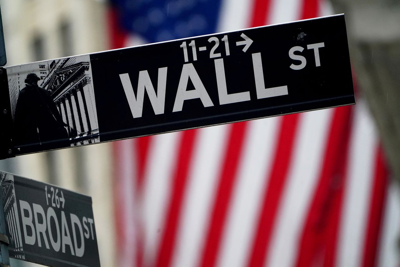 FILE PHOTO: A Wall Street sign outside the New York Stock Exchange in New York City, New York, U.S., October 2, 2020. REUTERS/Carlo Allegri/File Photo