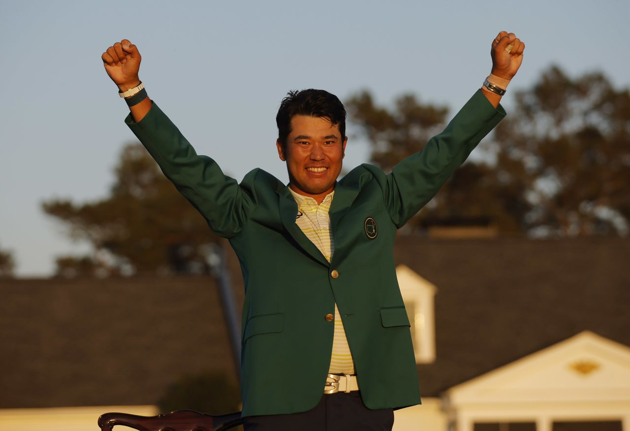 Golf - The Masters - Augusta National Golf Club - Augusta, Georgia, U.S. - April 11, 2021 Japan's Hideki Matsuyama celebrates with his green jacket after winning The Masters REUTERS/Brian Snyder
