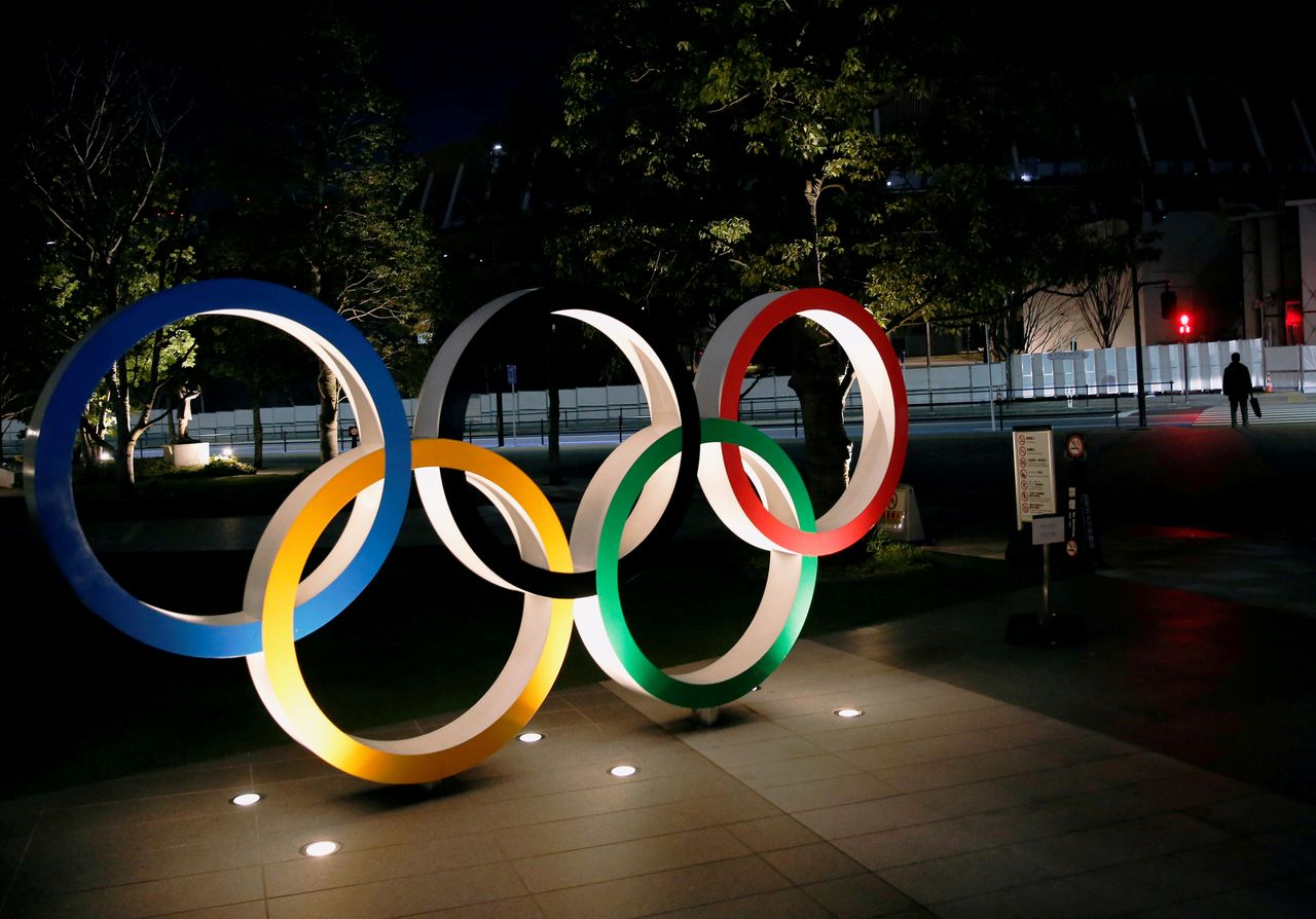 FILE PHOTO: The Olympic rings are illuminated in front of the National Stadium in Tokyo, Japan January 22, 2021. REUTERS/Kim Kyung-Hoon
