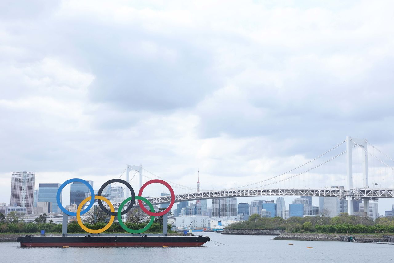 Apr 6, 2021; Tokyo, JAPAN; General view of the Olympic rings sculpture, Rainbow Bridge, and Tokyo Tower as seen from Odaiba in preparation for the Tokyo 2020 Olympic Summer Games set to begin in July 2021. Mandatory Credit: Yukihito Taguchi-USA TODAY Sports