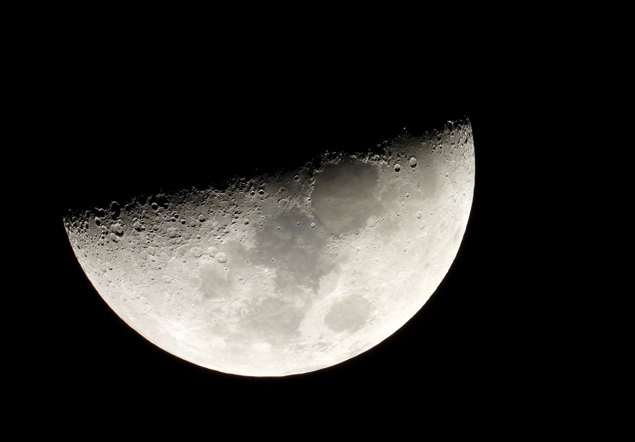FILE PHOTO: Moon is seen in the sky during the closest visible conjunction of Jupiter and Saturn in 400 years, in Tejeda, on the island of Gran Canaria, Spain December 21, 2020. REUTERS/Borja Suarez