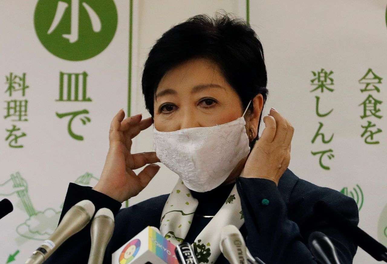 FILE PHOTO: Tokyo Governor Yuriko Koike wears a protective mask during a news conference about the city's response to the coronavirus disease (COVID-19) outbreak, in Tokyo, Japan November 25, 2020. REUTERS/Kim Kyung-Hoon