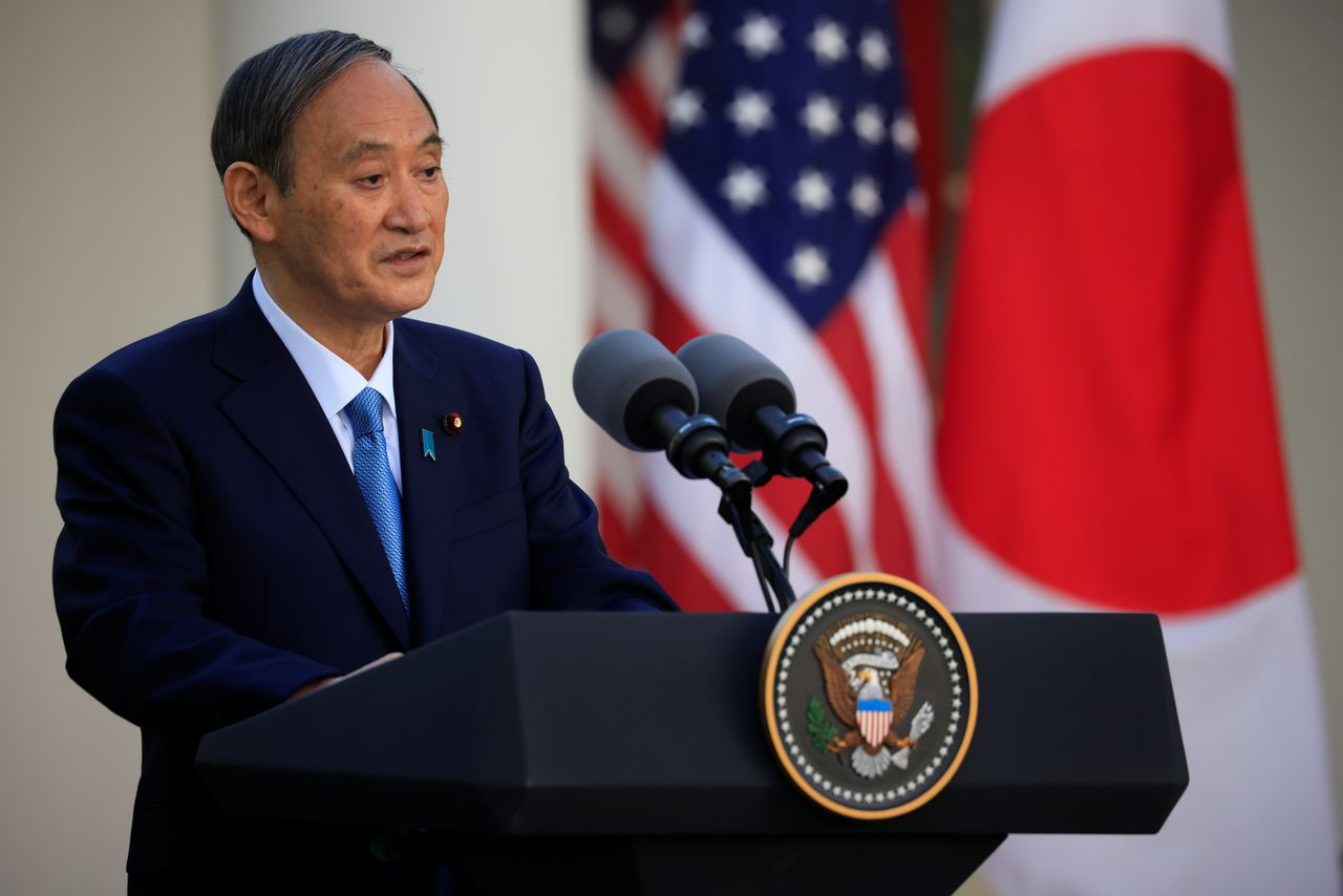 Japan's Prime Minister Yoshihide Suga addresses a joint news conference with U.S. President Joe Biden in the Rose Garden at the White House in Washington, U.S., April 16, 2021. REUTERS/Tom Brenner
