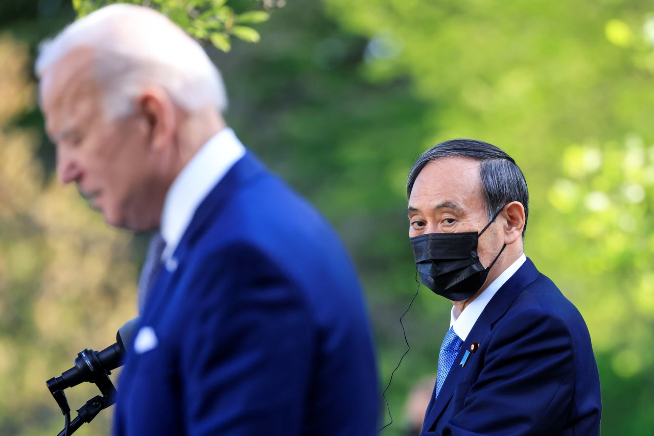 U.S. President Joe Biden holds a joint news conference with Japan's Prime Minister Yoshihide Suga in the Rose Garden at the White House in Washington, U.S., April 16, 2021. REUTERS/Tom Brenner