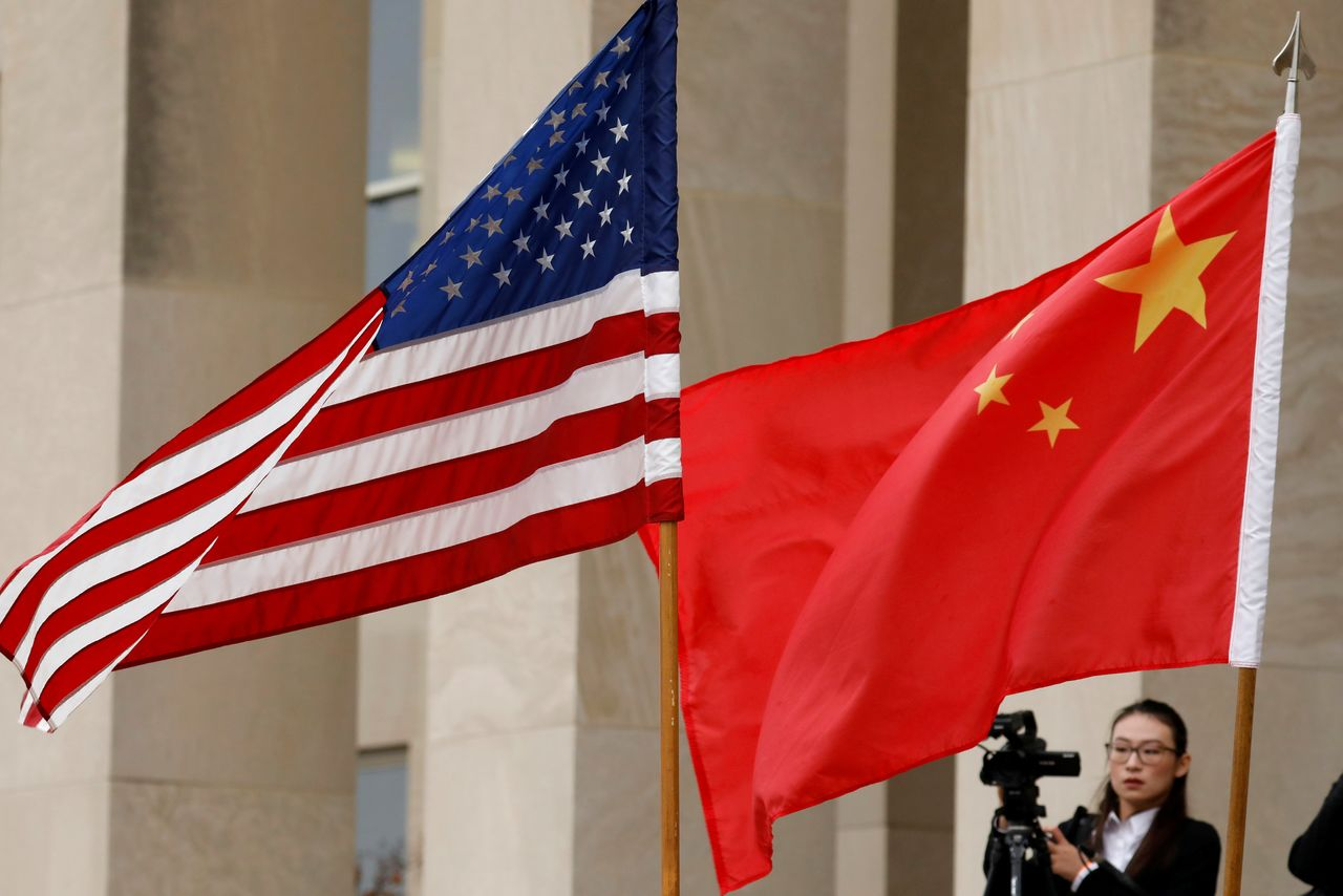 FILE PHOTO: U.S. and Chinese flags are seen before a meeting between senior defence officials from both countries at the Pentagon in Arlington, Virginia, U.S., November 9, 2018. REUTERS/Yuri Gripas