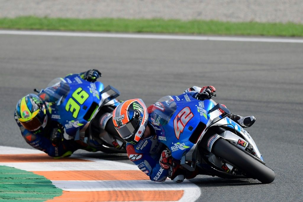 Joan Mir (left) and Alex Rins finished first and third in the MotoGP riders' championship to secure the team title for Suzuki which has committed until 2026. AFP