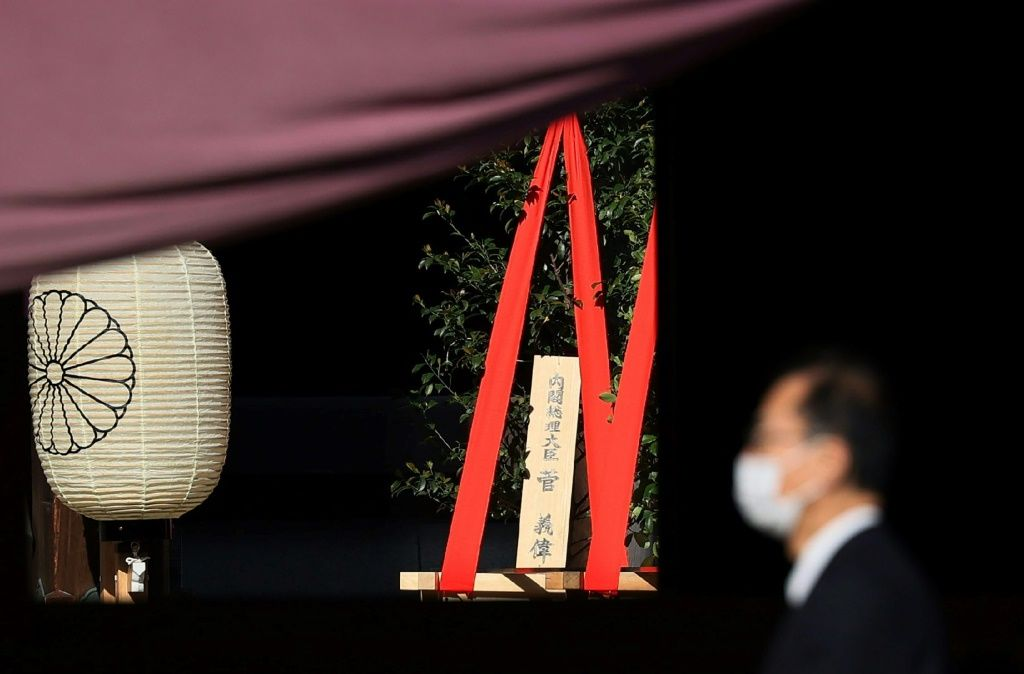 Japanese Prime Minister Yoshihide Suga sent a sacred tree to the controversial Yasukuni shrine. AFP