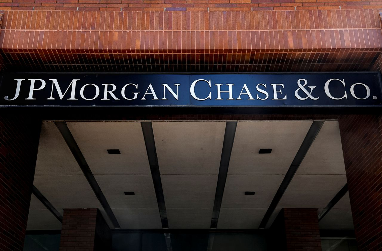 FILE PHOTO: A sign outside JP Morgan Chase & Co. offices is seen in New York City, U.S., March 29, 2021.  REUTERS/Brendan McDermid